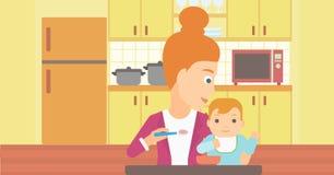 Woman feeding baby. Royalty Free Stock Image