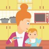 Woman feeding baby. Royalty Free Stock Photos