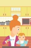 Woman feeding baby. Royalty Free Stock Photography