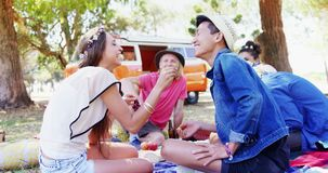 Woman feeding berry to man at music festival 4k. Happy woman feeding berry to man at music festival 4k stock video