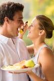 Woman feeding boyfriend breakfast Stock Image
