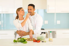 Woman feeding boyfriend Stock Photography