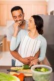 Woman feeding boyfriend cucumber Royalty Free Stock Photos