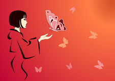 Woman feeding butterflies Stock Photography