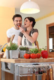 Woman feeding carrot to husband Royalty Free Stock Images