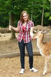 Woman feeding a deer in the zoo Royalty Free Stock Photo