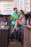 Woman Feeding Food To Man In Kitchen Royalty Free Stock Image