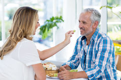 Woman feeding grapes to husband Royalty Free Stock Photos