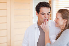 Woman feeding her boyfriend Stock Photography