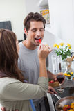 Woman feeding her husband bell pepper Royalty Free Stock Photos