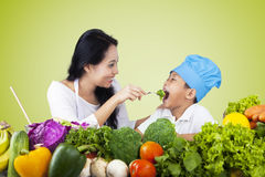 Woman feeding her son with healthy food Stock Photo