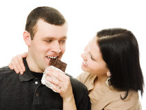 Woman feeding a man chocolate . Stock Images