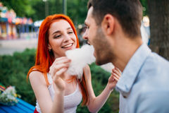 Woman feeding man cotton candy, romantic date Royalty Free Stock Photos