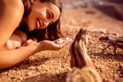 Woman feeding moorish squirrel Stock Image