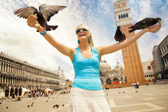 Woman feeding pigeons Royalty Free Stock Photography