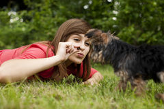 Woman feeding puppy Stock Photo