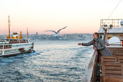Woman feeding Sea Gulls from Board of Tourist Boat Royalty Free Stock Images