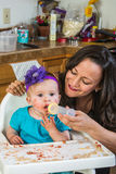 Woman Feeds Baby Stock Photos