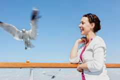 Woman feeds seagulls. Stock Image