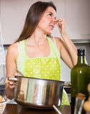 Woman feel bad smell from pan Stock Image