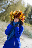 Woman feel cold while walking at park Royalty Free Stock Images
