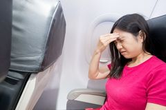 Woman feel headache in airplane. Middle aged woman feel headache in the airplane royalty free stock photos