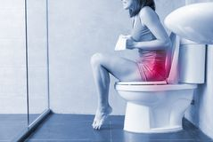 Woman feel pain with constipation. In wc Stock Photography