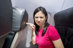 Woman feel seat small. In the airplane Royalty Free Stock Photo
