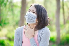 Woman feel sore throat. Woman wear mask and feel sore throat stock images