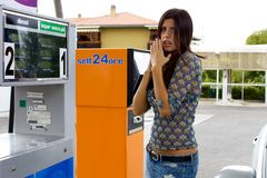 Woman feeling bad for high price of gasoline. The gasoline price went up like crazy Royalty Free Stock Images
