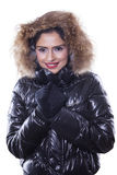 Woman feeling cold and wearing winter jacket Royalty Free Stock Photos