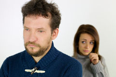 Woman feeling guilty after fight looking sad husband Stock Images