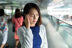 Woman feeling headache in the foot bridge Royalty Free Stock Images