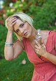 Woman feeling hot Stock Photography