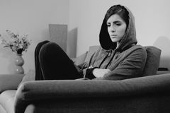 Woman feeling lonely and heart broken at home stock photography