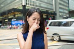 Woman feeling nose allergy at outdoor Royalty Free Stock Images