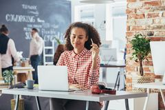 Woman feeling relaxed at work stock images