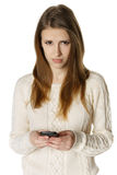Woman is feeling sad while reading sms Stock Photo