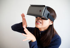 Woman feeling scary with virtual reality glasses Stock Photo