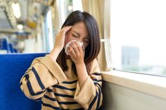 Woman feeling sick inside train compartment Stock Photo