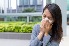 Woman feeling sick at outdoor. Asian young woman Stock Image