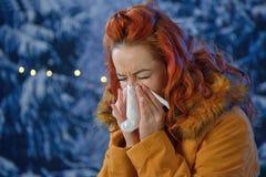 Woman feeling sick. In winter time Stock Photos