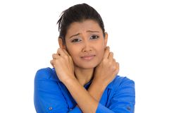 Woman feeling sorry. Closeup portrait of pretty young woman pulling gripping ears sorry for what she did, isolated on white background. Negative human emotions Royalty Free Stock Images