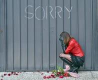 Woman. Feeling sorry on a door Stock Photo