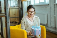 Woman feeling surprised after receiving present from her husband royalty free stock photos