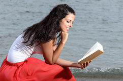 Woman feeling tranquility reading a book Stock Photography