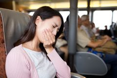 Woman feeling unwell on boat. Asian young woman Stock Image