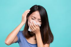 Woman feeling unwell and headache. Asian young woman Stock Image