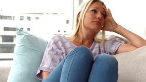 Woman feeling upset on sofa. In ultra hd format stock video footage