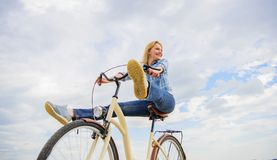 Woman feels free while enjoy cycling. Girl rides bicycle sky background. Most satisfying form of self transportation. Carefree and satisfied. Cycling gives you stock images